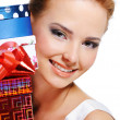 Pretty smiling girl with the  presents - Stockfoto