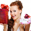 Woman choosing between two presents — Stock Photo