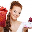 Smiling girl choosing between two gifts — Stock Photo #1502696
