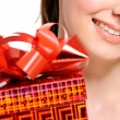 Girl with a red present box — Stock Photo #1502721