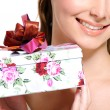 Half female face with present box — Stock Photo #1502744