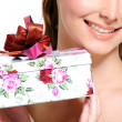 Stock Photo: Half female face with present box