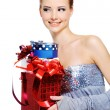 Femlae holding the christmas present — Stock Photo #1502893