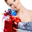 Stock Photo: Smiling beautiful girl with gift boxes