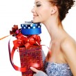 Profile portrait of a woman with gift — Stock Photo #1502920