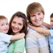 Portrait of happy young family - Stockfoto