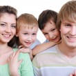 Young happy smiling family — Stock Photo