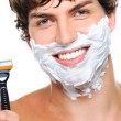 Happy male face with razor — Stock Photo #1503382