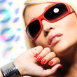 Blond woman in red sunglasses — Stock Photo
