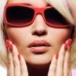 Female face in fashion red sunglasses — Stock Photo