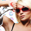 Woman with red sunglasses — Stockfoto