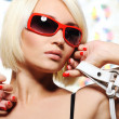Woman in bright red sunglasses — Stockfoto