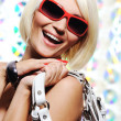 Happy woman with red sunglasses — Стоковое фото