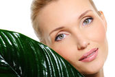 Sensitive woman face with leaf — Stock Photo