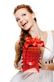 Happy laughing woman with present — Stock Photo