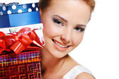 Pretty smiling girl with the presents — Stok fotoğraf