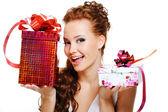 Woman choosing between two presents — Stock Photo
