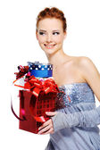 Femlae holding the christmas present — Stock Photo