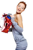 Woman holding the christmas boxes — Stock Photo