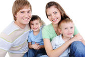 Happy family with two sons — Stock Photo