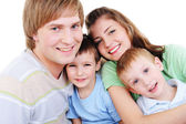 Portrait of loving happy young family — Stock Photo