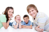 Happy young family with two sons — Stock Photo
