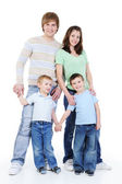 Full portrait of young happy family — Stock Photo