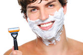 Happy male face with razor — Stock Photo