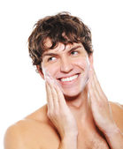 Man applying moisturizing cream — Stock Photo