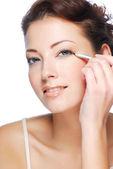 Woman making make-up — Stock Photo