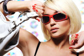 Woman with red sunglasses — Stock Photo