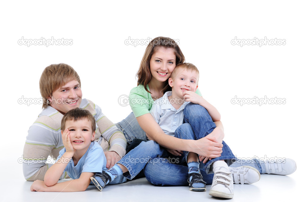Happy young family of four family enjoing together - isolated — Stock Photo #1503082