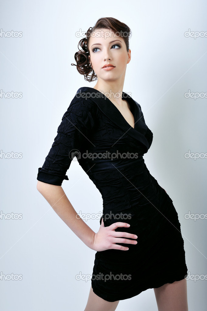 Pretty woman with slim waist pose on white background dressed in style black dress — Stock Photo #1504325
