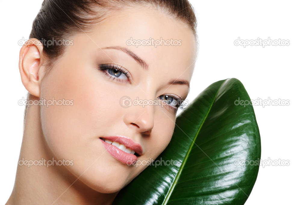 Beauty clear woman face near green leaf over white background — Stock Photo #1505919
