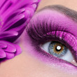 Purple eye make-up with gerber flower - Stok fotoğraf