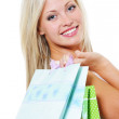 Portrait of woman with purchases — Stock Photo