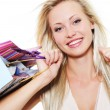 Happy woman with purchases - Stock Photo