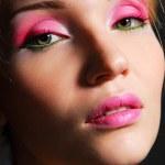 Mädchen mit hell rosa schminken — Stockfoto