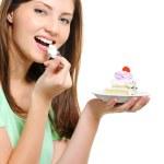 Beautiful woman eating cake — Stock Photo