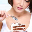 Beautiful woman and sweet cake - Stock Photo