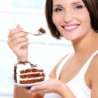 Woman with cake on plate — Stock Photo
