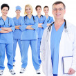 Foto Stock: Mature male doctor with colleagues