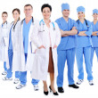 Happy smiling doctors and surgeons - Stock Photo