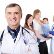 Mature doctor and  young happy family - Stock Photo