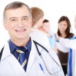 Mature doctor and family — Stock Photo