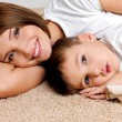 Stock Photo: Smiling mother and the child