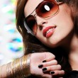 Brunette woman in stylish sunglasses — Stock Photo