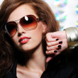Girl in the modern sunglasses — Stock Photo