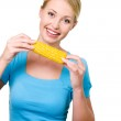 Smiling woman with raw corn — Stock Photo #1519745
