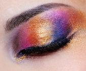 Closed eye with multicoloured eyeshadow — Stock Photo
